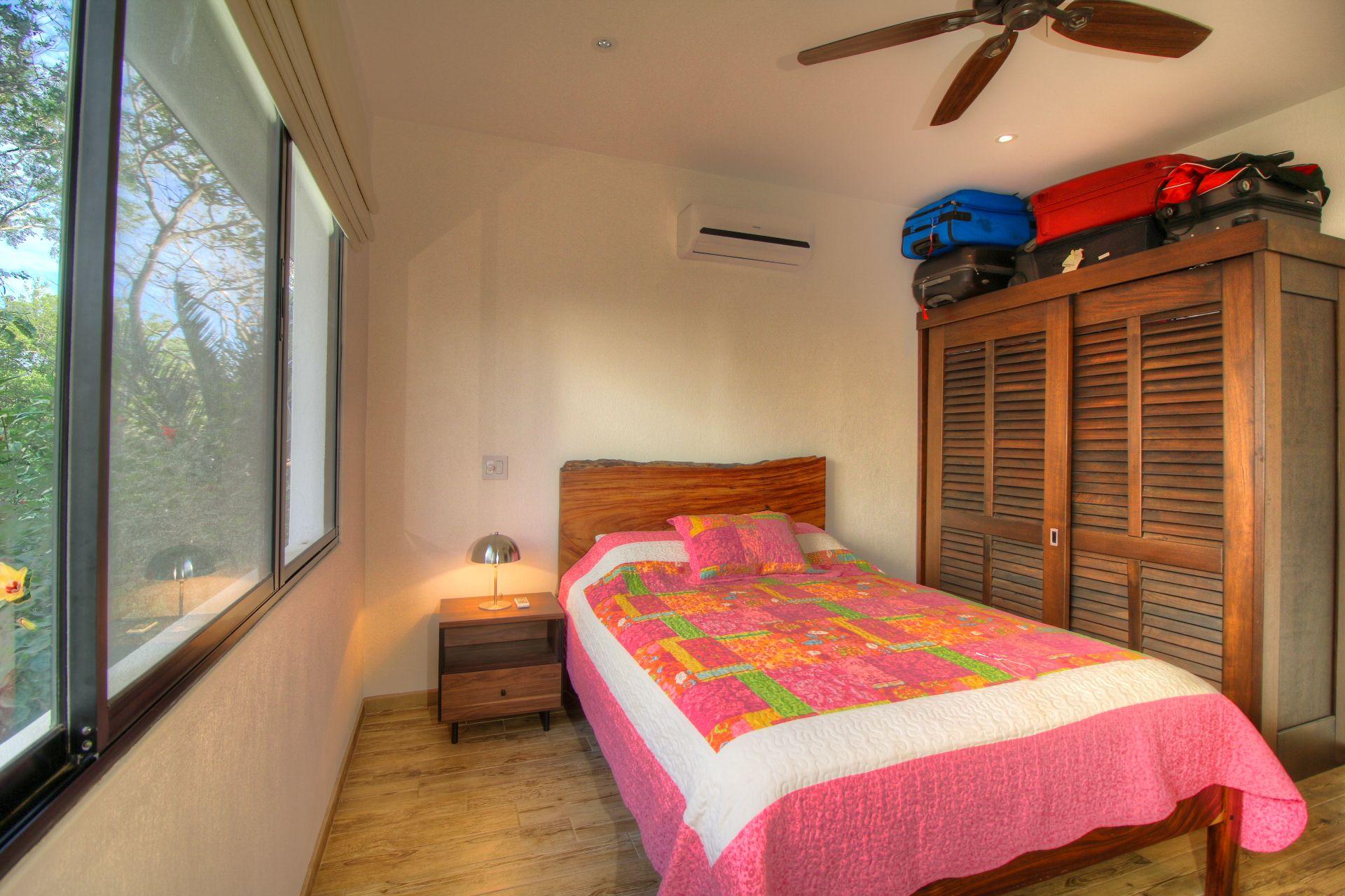 Guest bedroom overlooking treetops