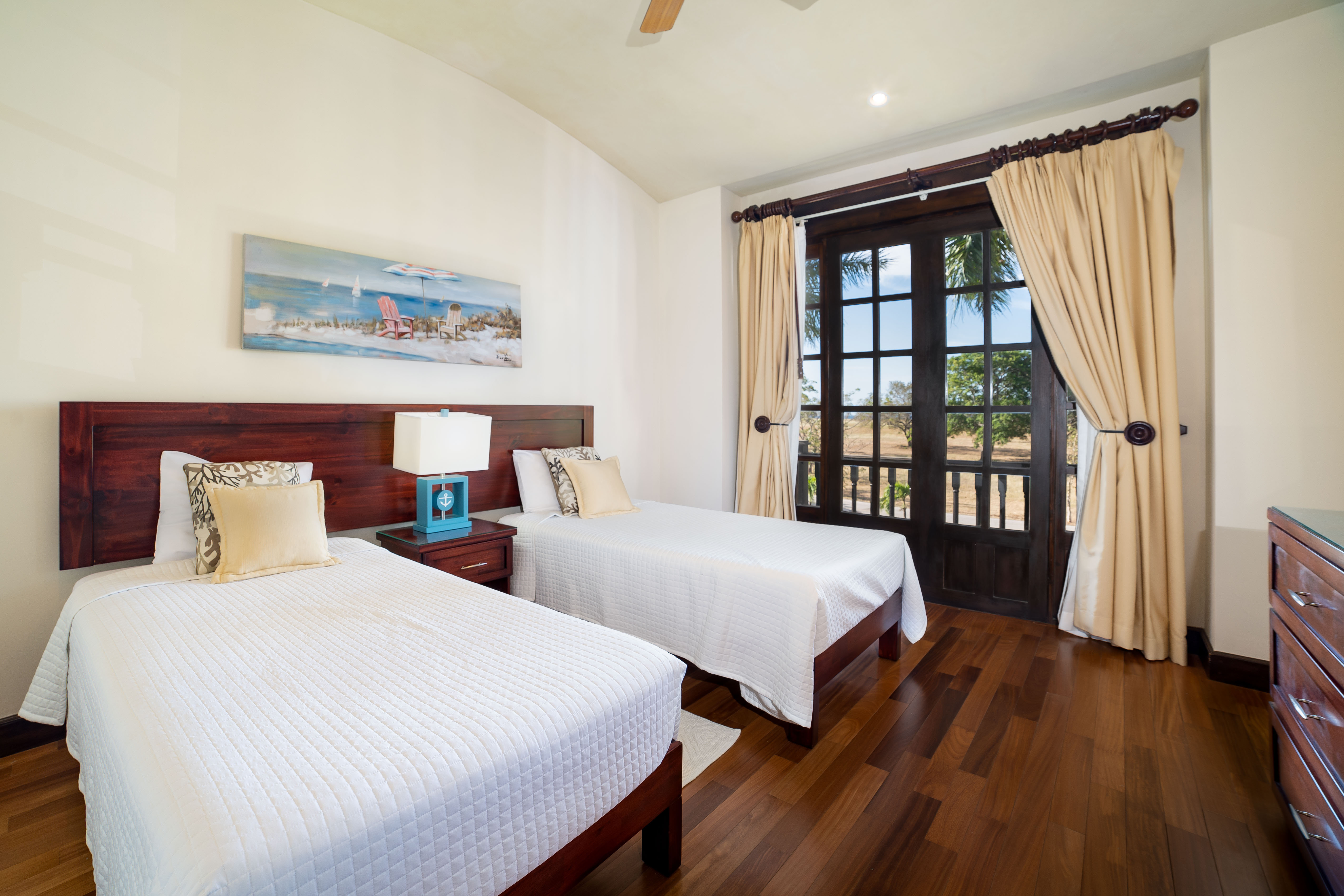 Luxury twin beds with a balcony view