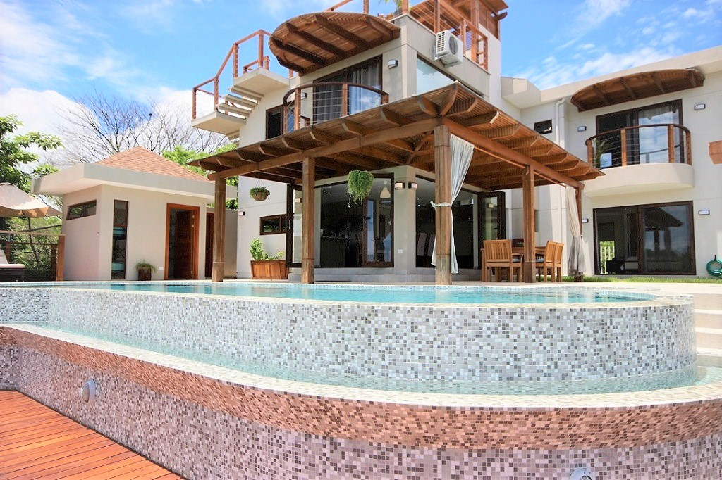 Pool area and house