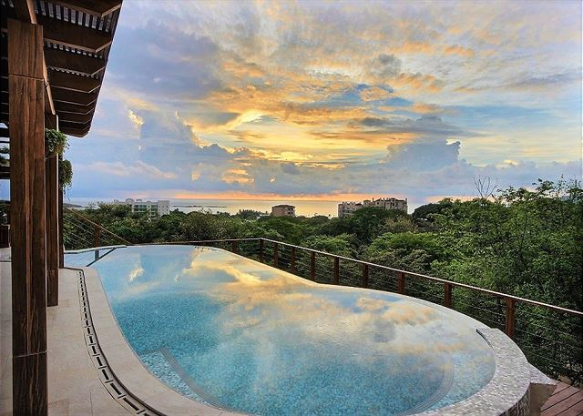 Enjoy a beautiful sunset by the pool