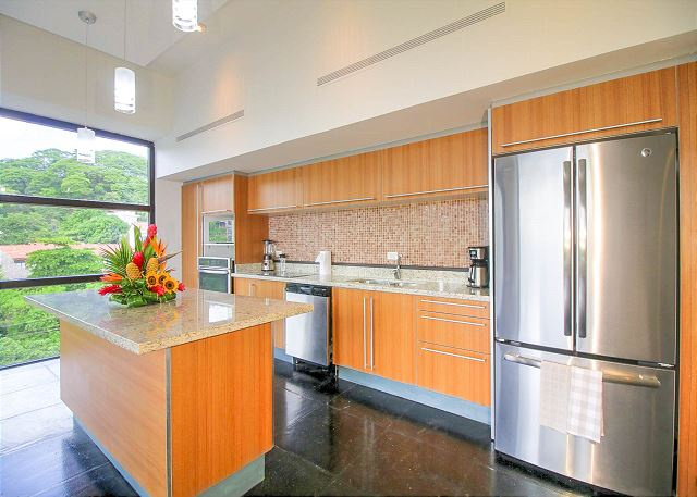 Kitchen with simple modern lines and stainless appliances