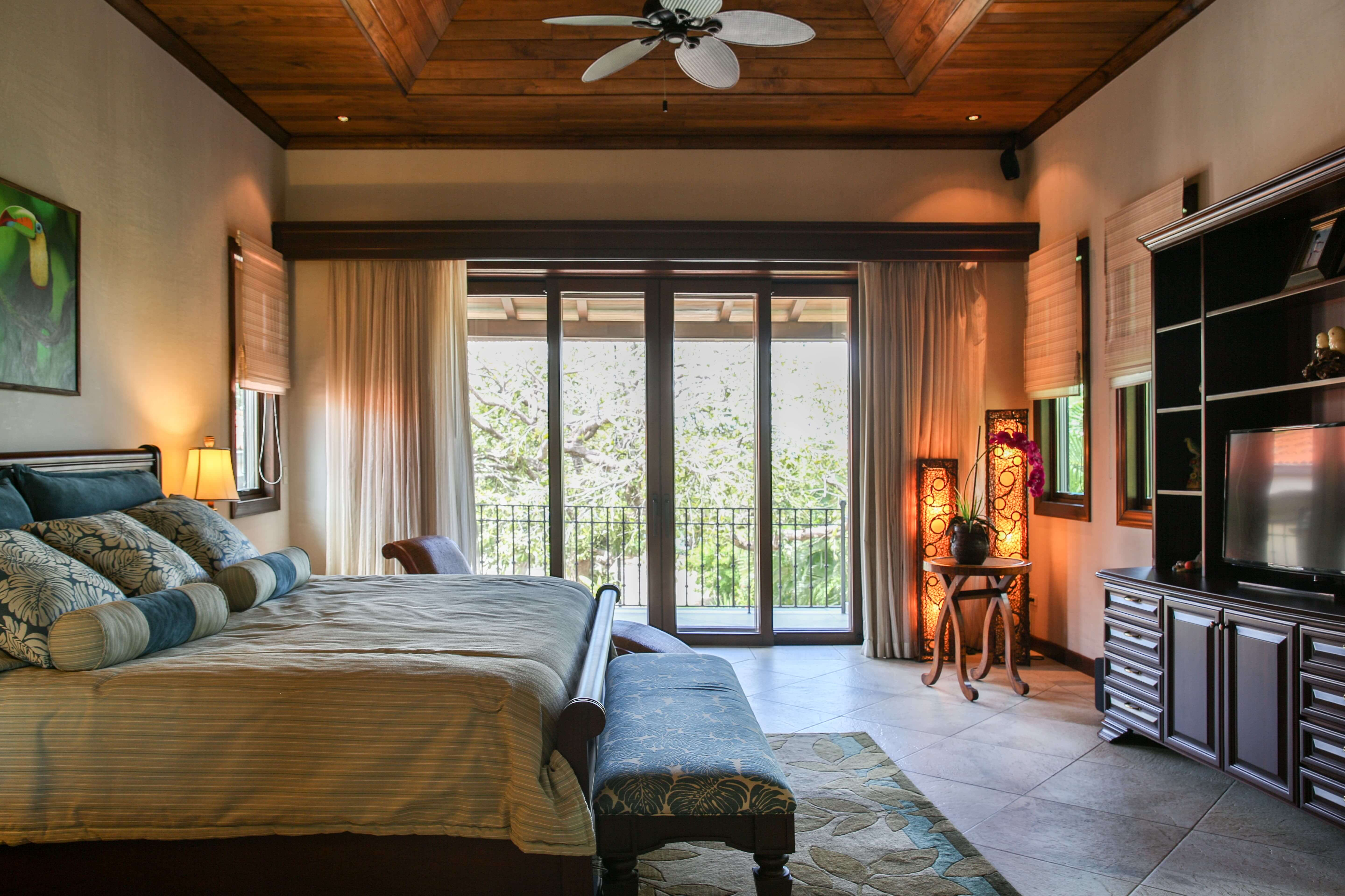 Bedroom with television and sliding glass door