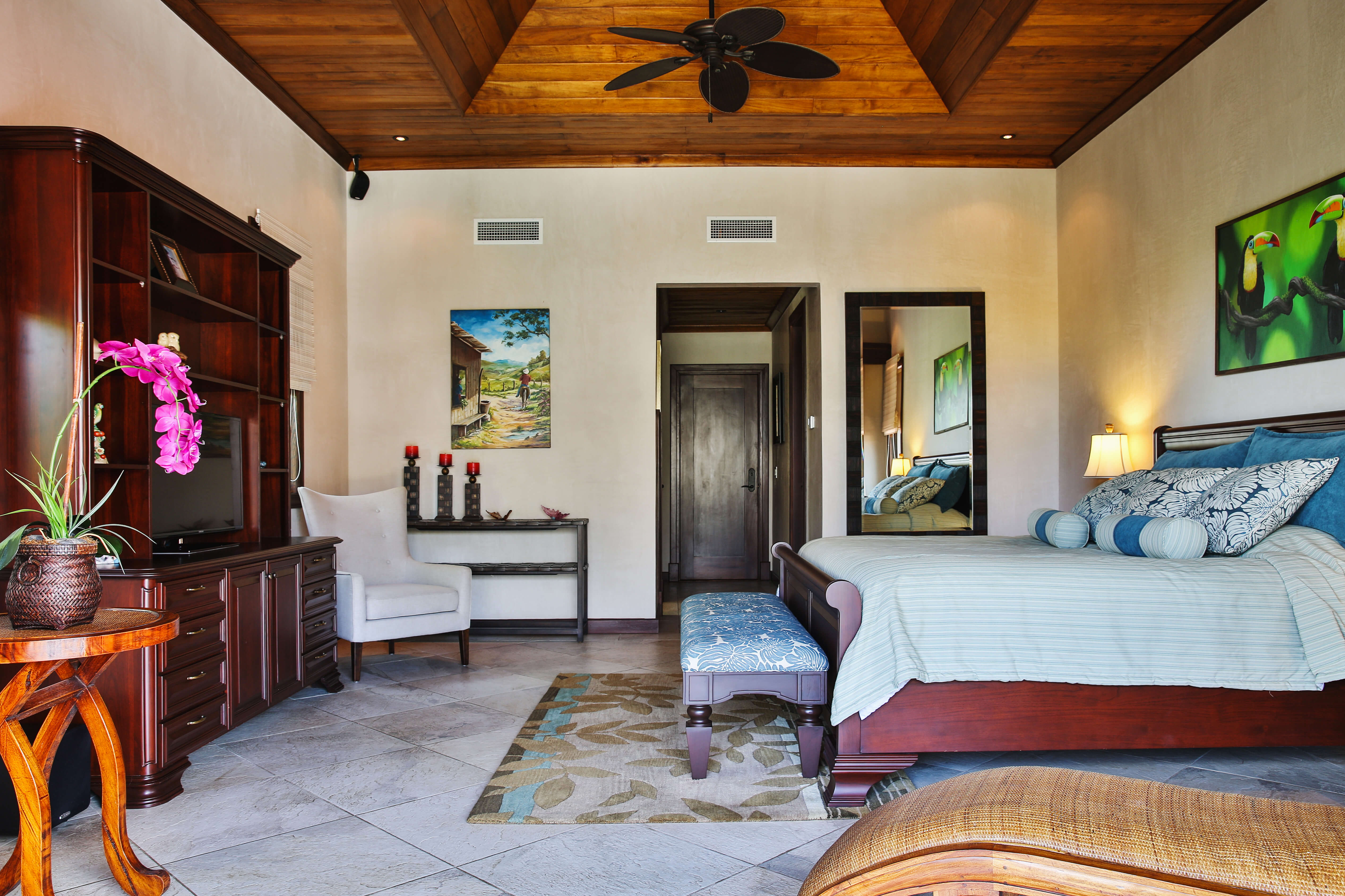 Bedroom with recessed wood ceiling