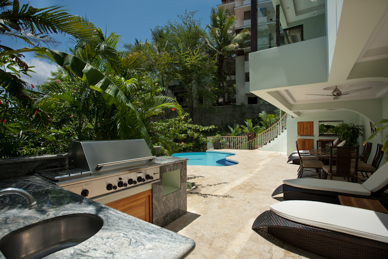 Gas grill and food prep area by the pool