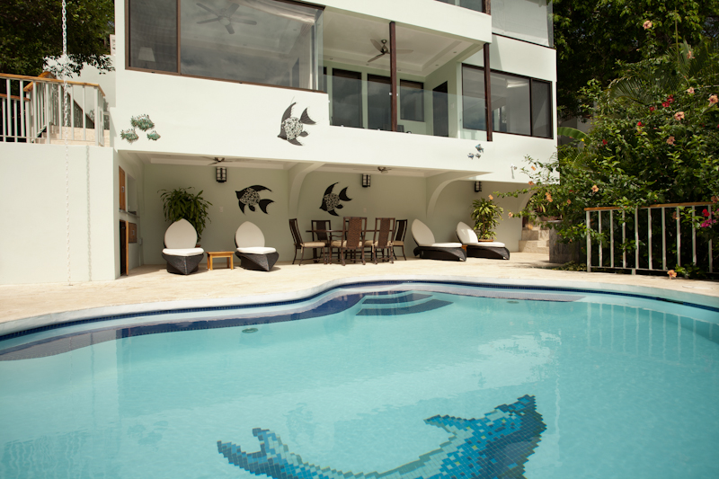 Enjoy sun or shade by the pool