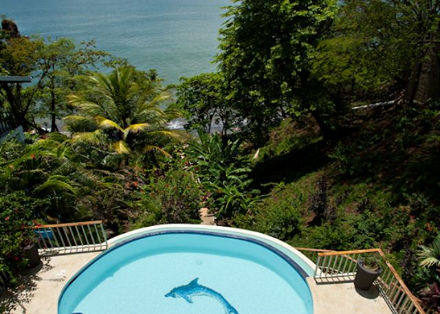 From Casa Colibri, it is just steps down to the sandy beach