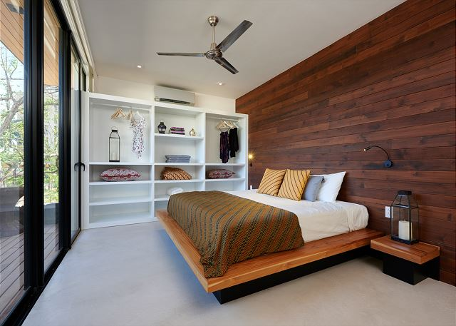 Ample guest bedroom with king bed