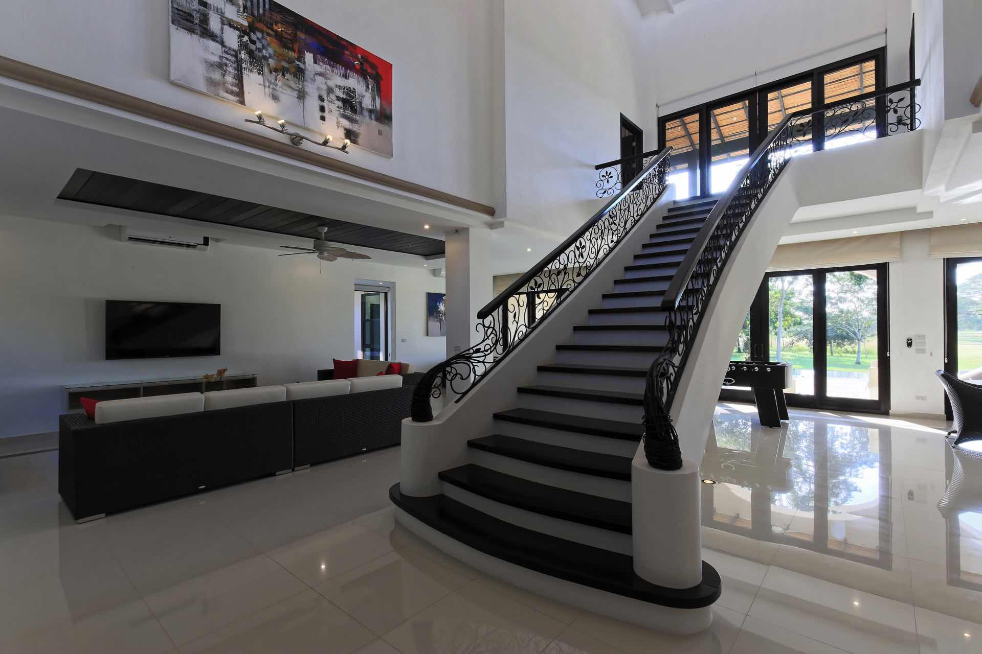 Staircase to upstair bedrooms and balcony