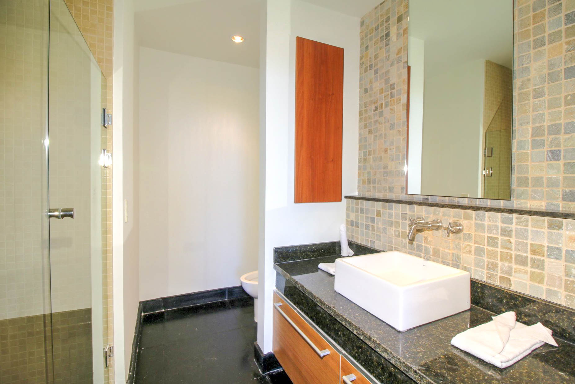 Bath with stone tile and granite