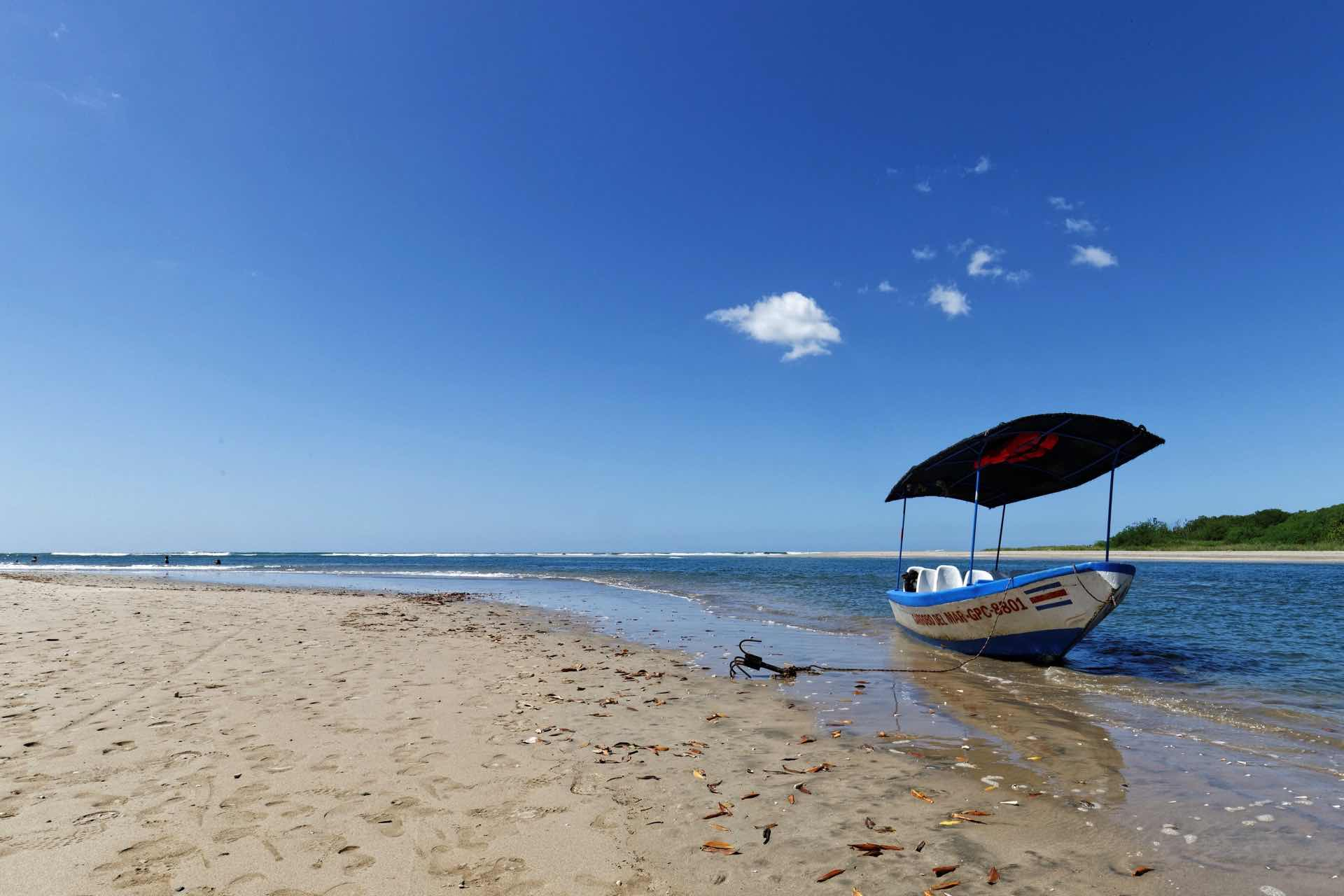Panga boat waiting in the Tamarindo estuary