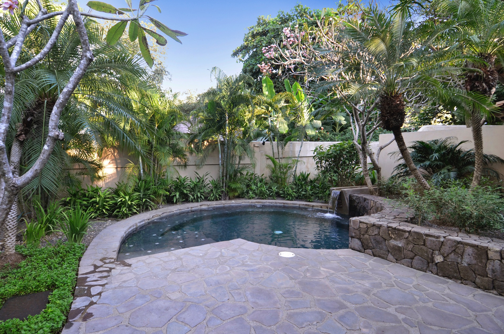 Swimming pool enclosed in stone terrace