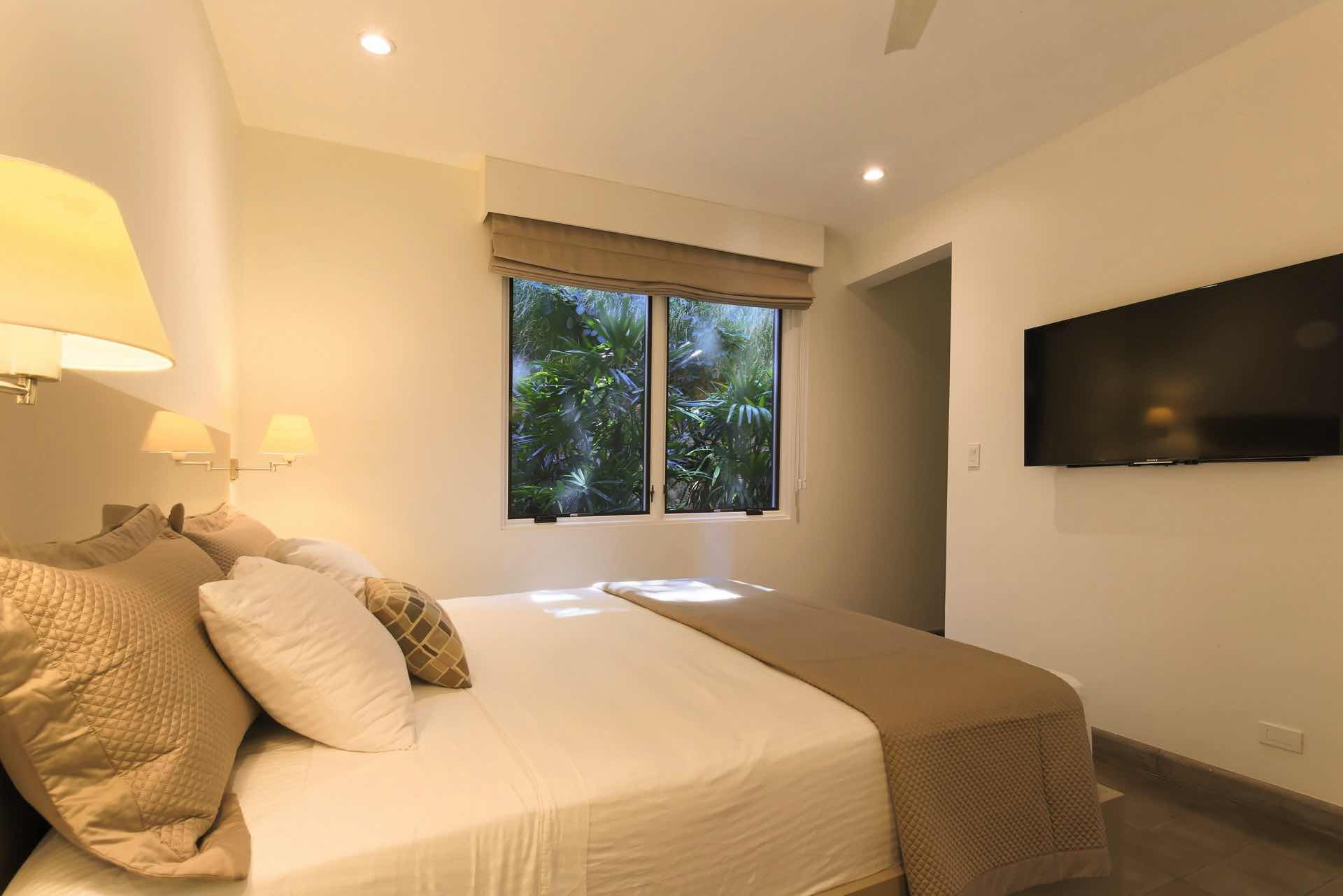Each bedroom has a private bath and flat screen tv