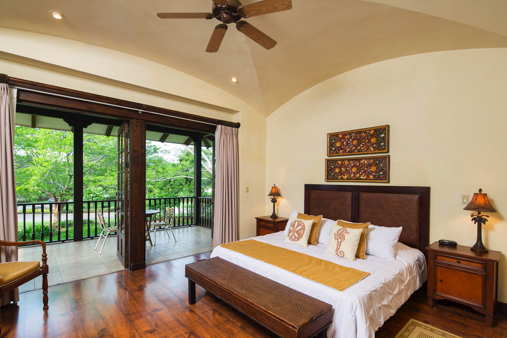 Master bedroom with king bed, steps from balcony