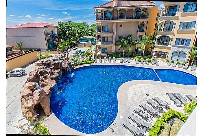 Sun terrace and resort pool with waterfall