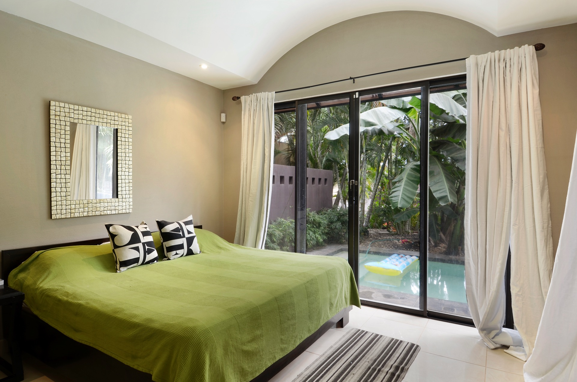 Bedroom with king bed and steps to pool