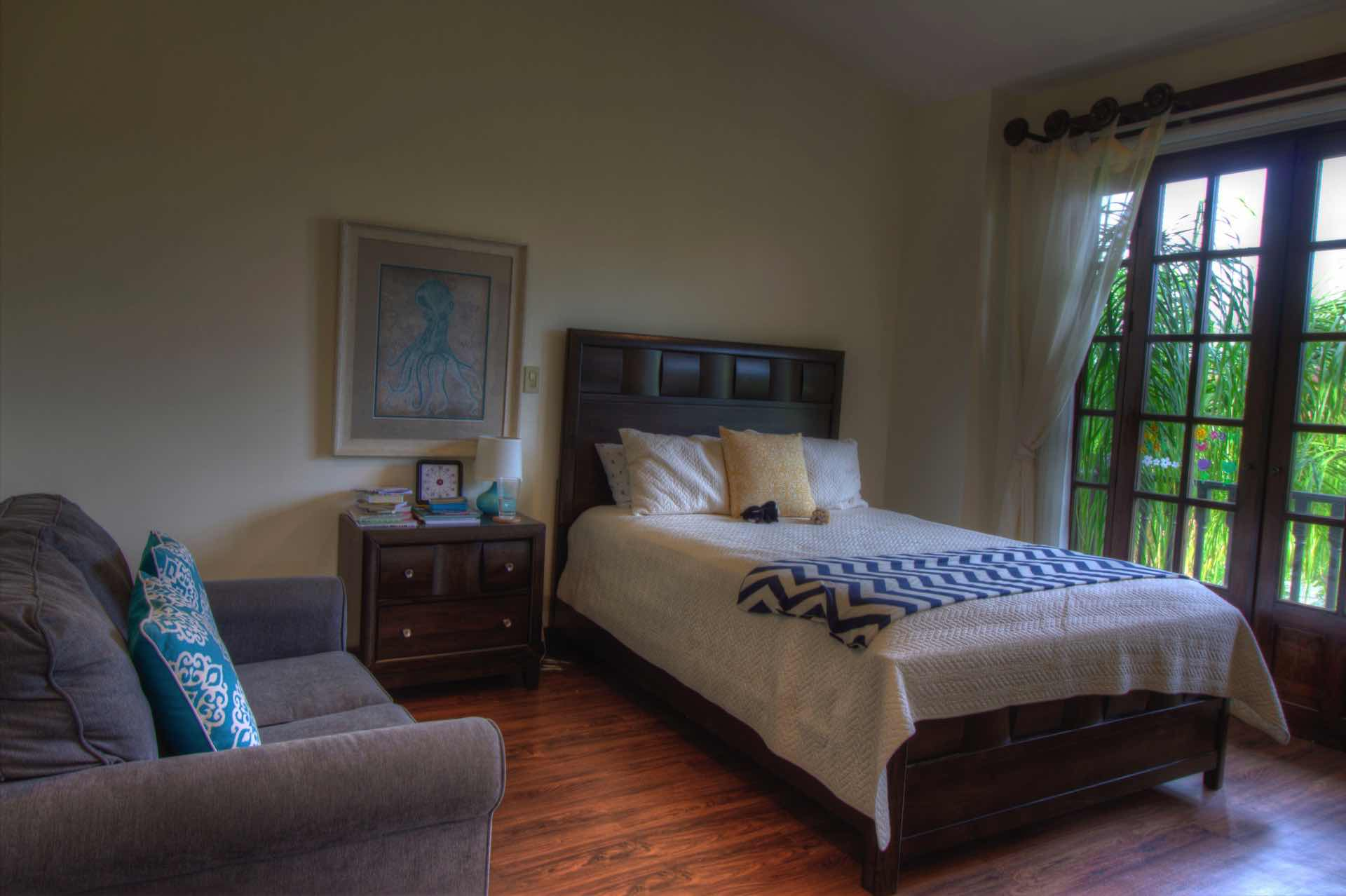 Guest Bedroom with Queen Bed and Sofa