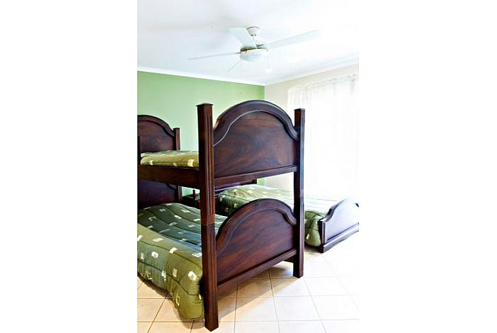 Guest bedroom with twin and bunk beds
