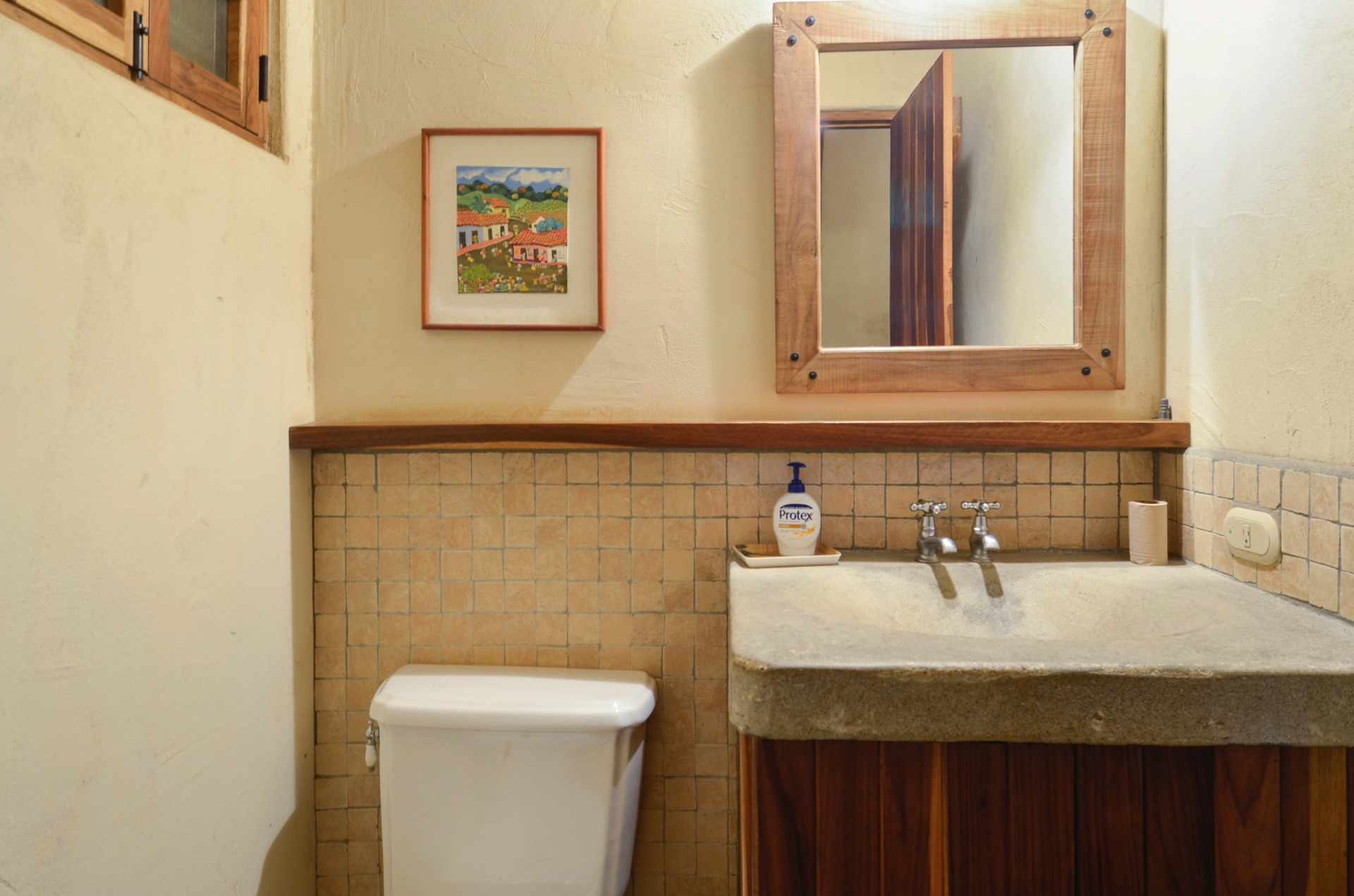 Bath accented with beautiful wood elements
