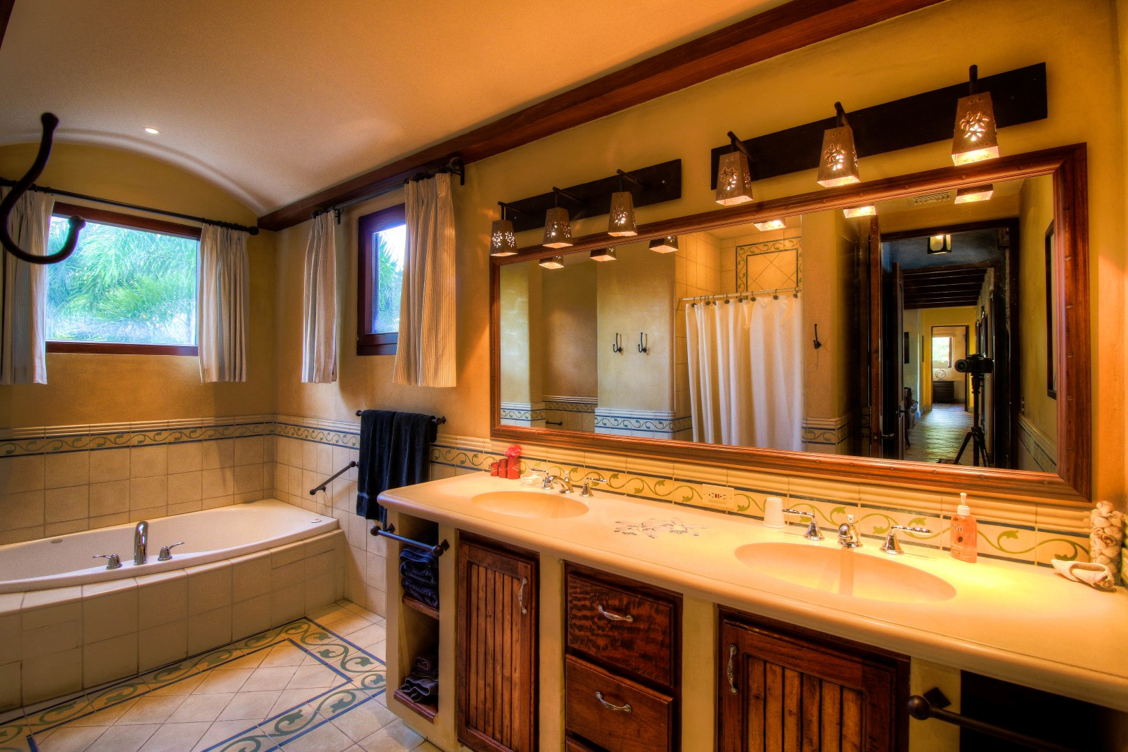 Bathroom with double sink, shower and tub