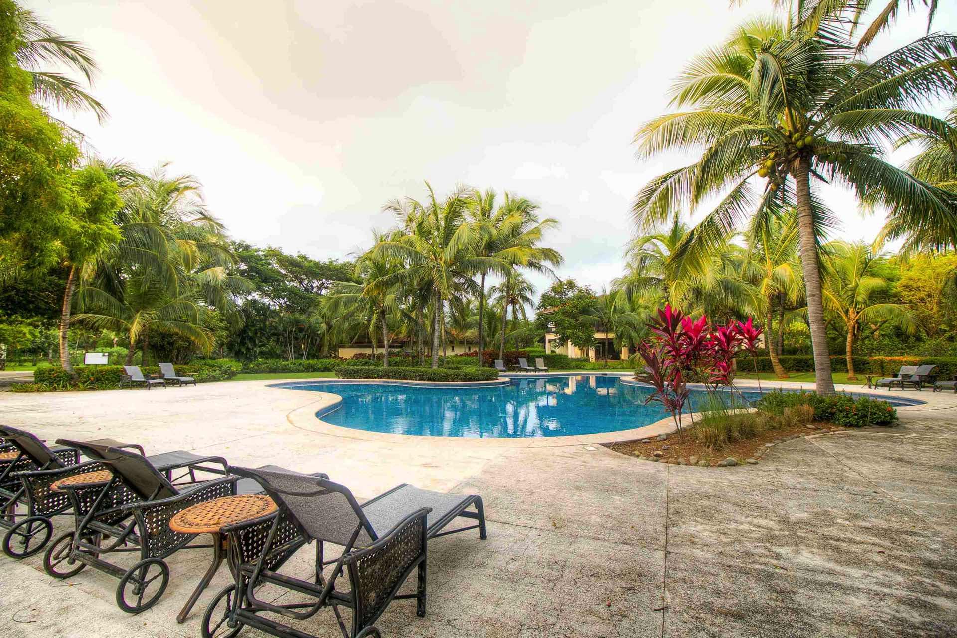 Resort pool shared by Villa Mansita