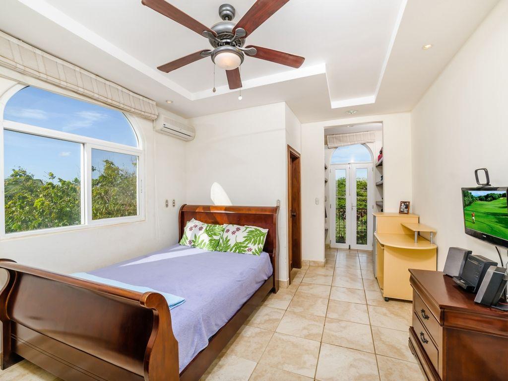 Bright queen bedroom.