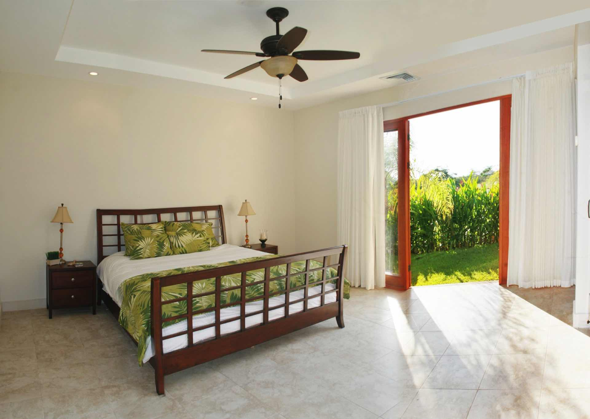 Bedroom with king size bed and garden access