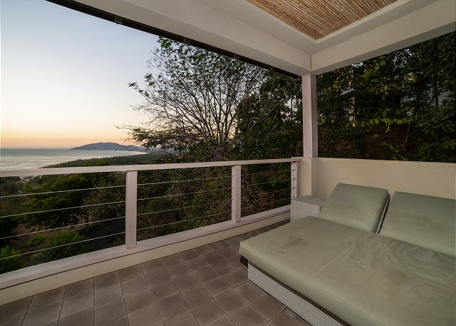 Relax on the Master balcony at sunset