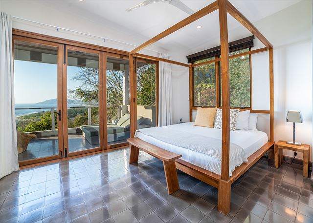 Master bedroom with ocean view and king bed