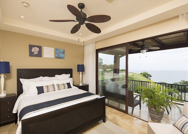 Bedroom opens on to ocean-view terrace