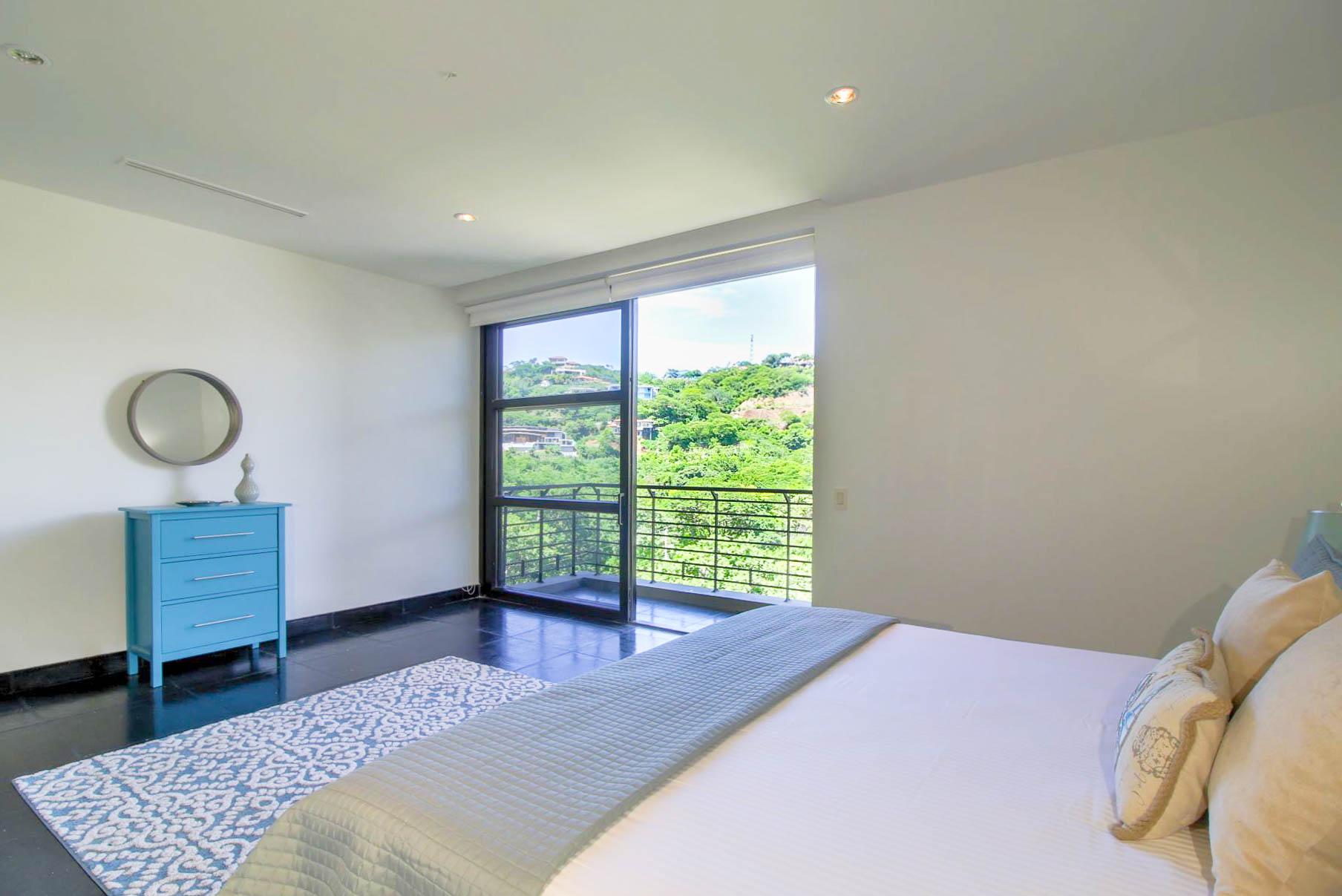 Floor to ceiling windows and sliding door to balcony