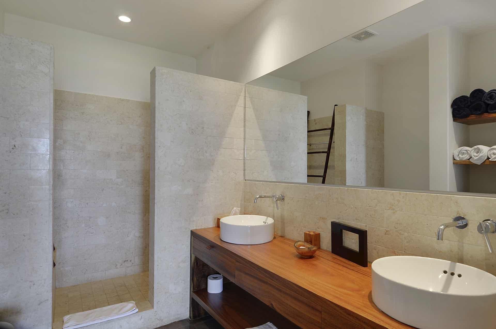 Double sinks and stone-tiled shower