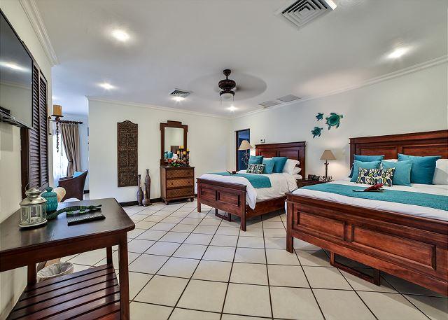 Elegant bedroom with two queen beds