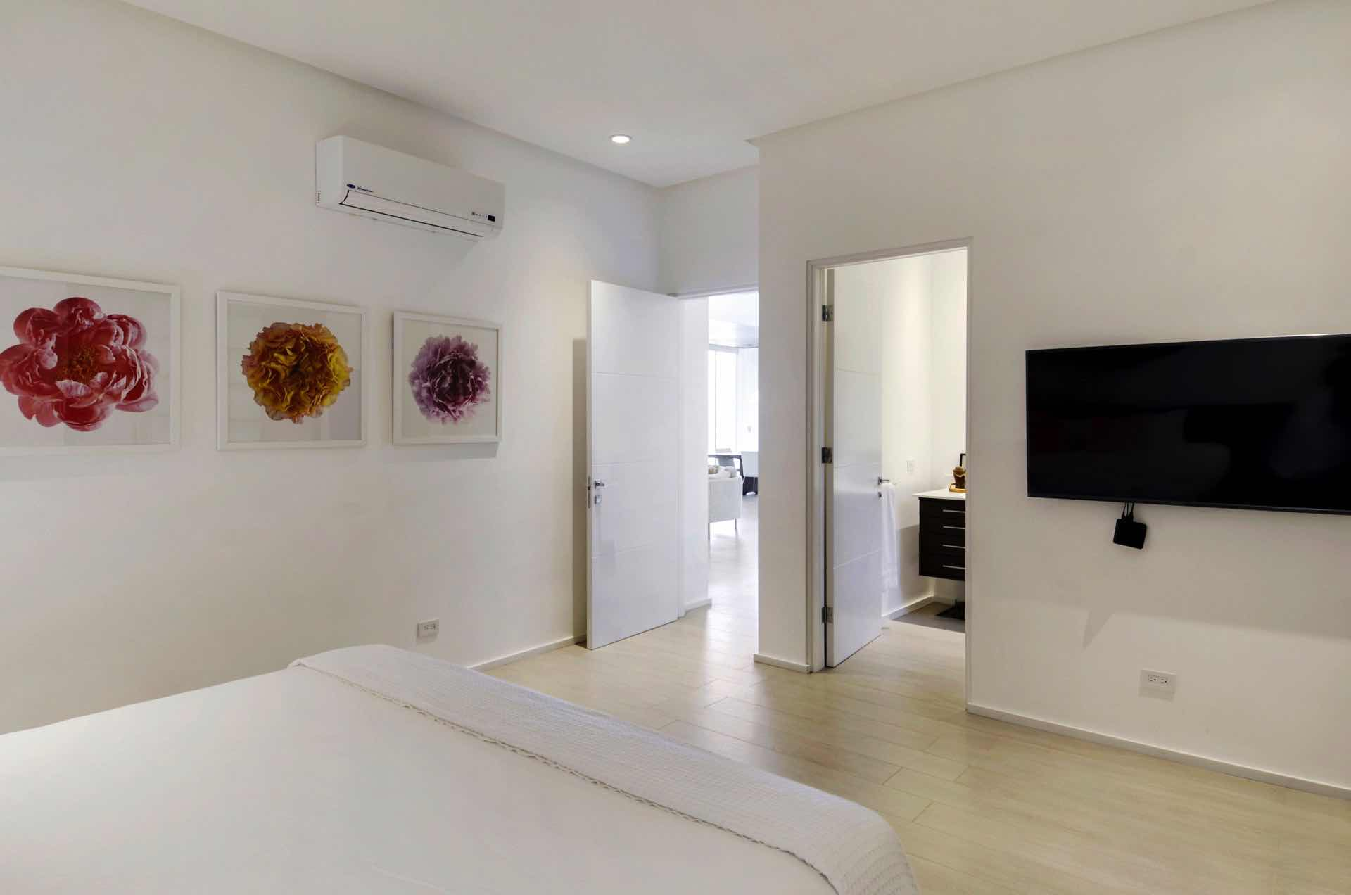 A second view of guest suite with flat screen tv