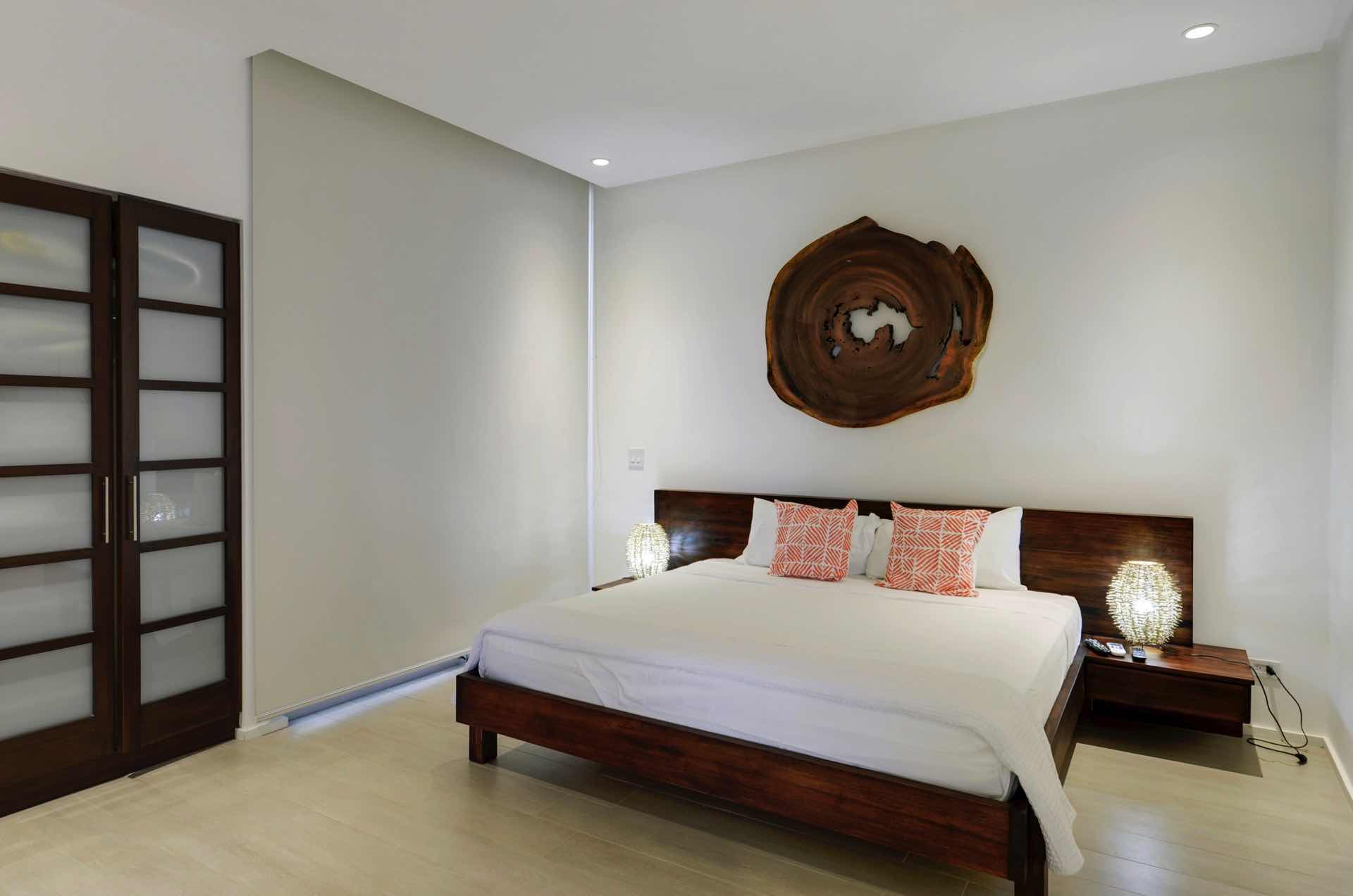 Guest bedroom with natural wood artwork
