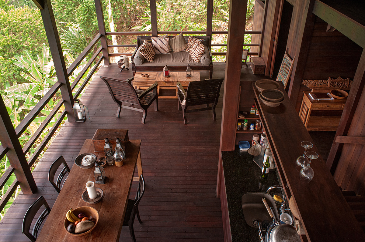 Open air home with sitting area, dining table, kitchen