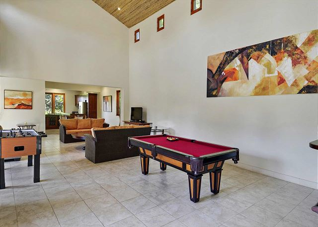 Spacious living area with pool table and foosball