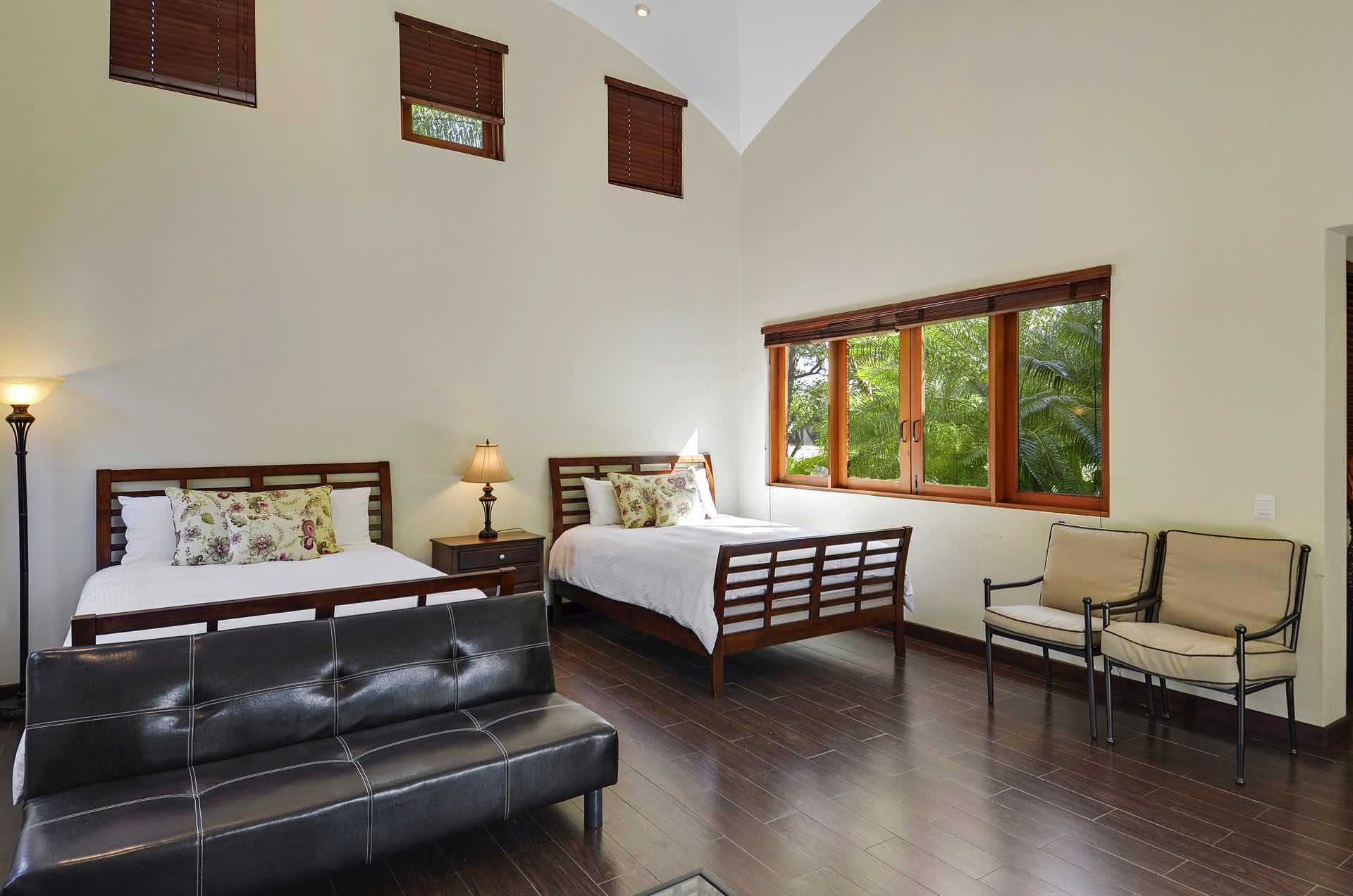 Poolside suite beside main house with two queen beds