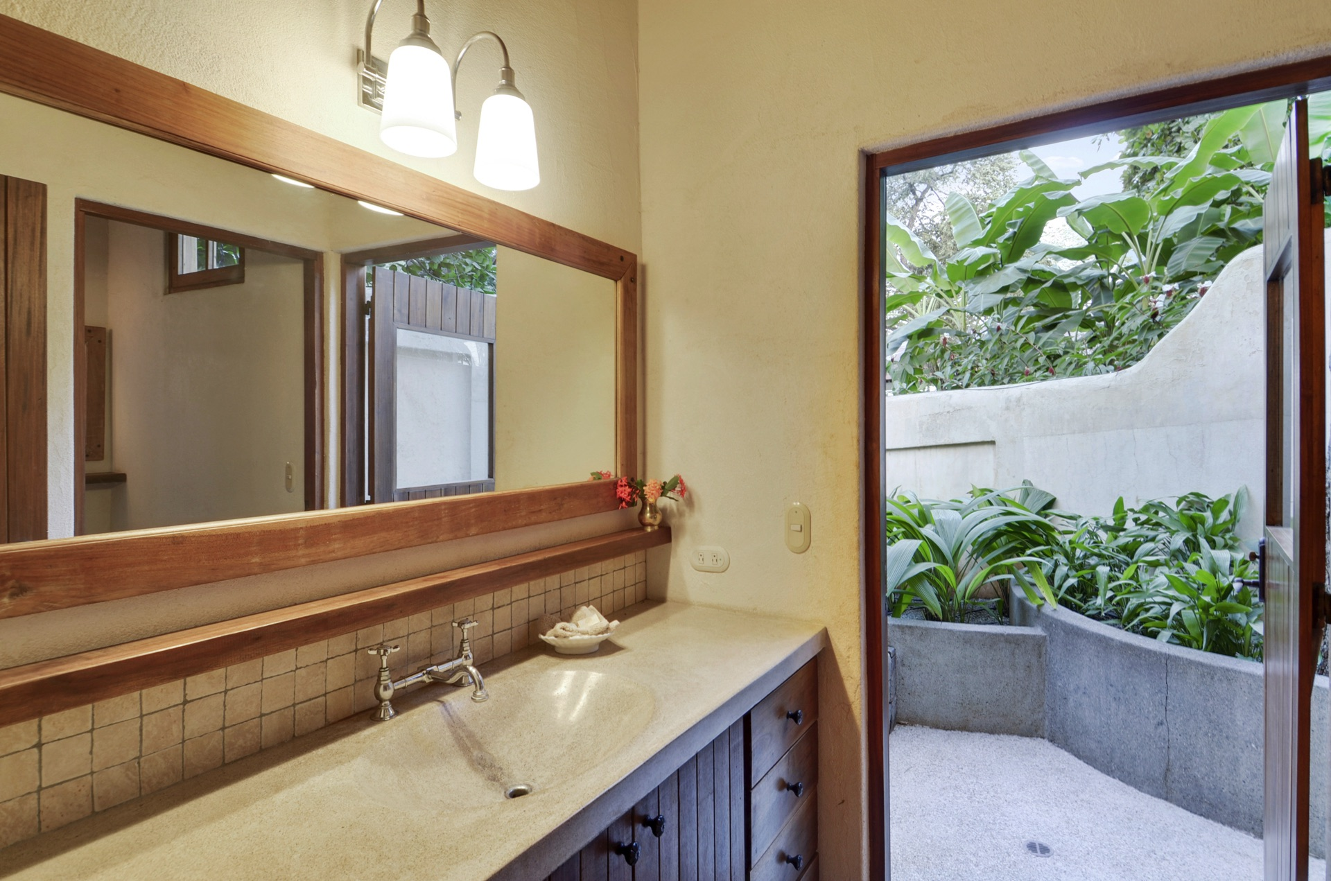 Bath opens to private outdoor shower