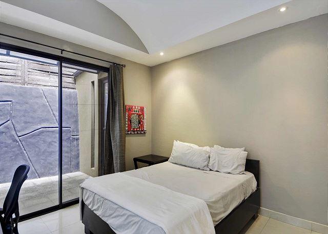 Guest bedroom with sliding glass doors