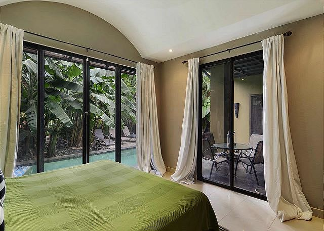 Poolside room with doors to terrace and pool