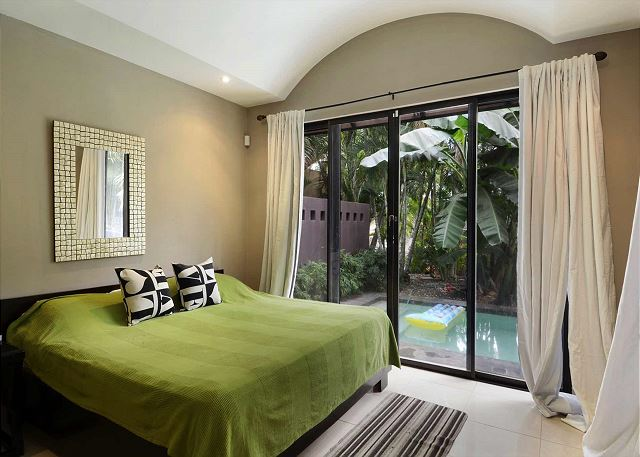 Bedroom with king bed and pool access