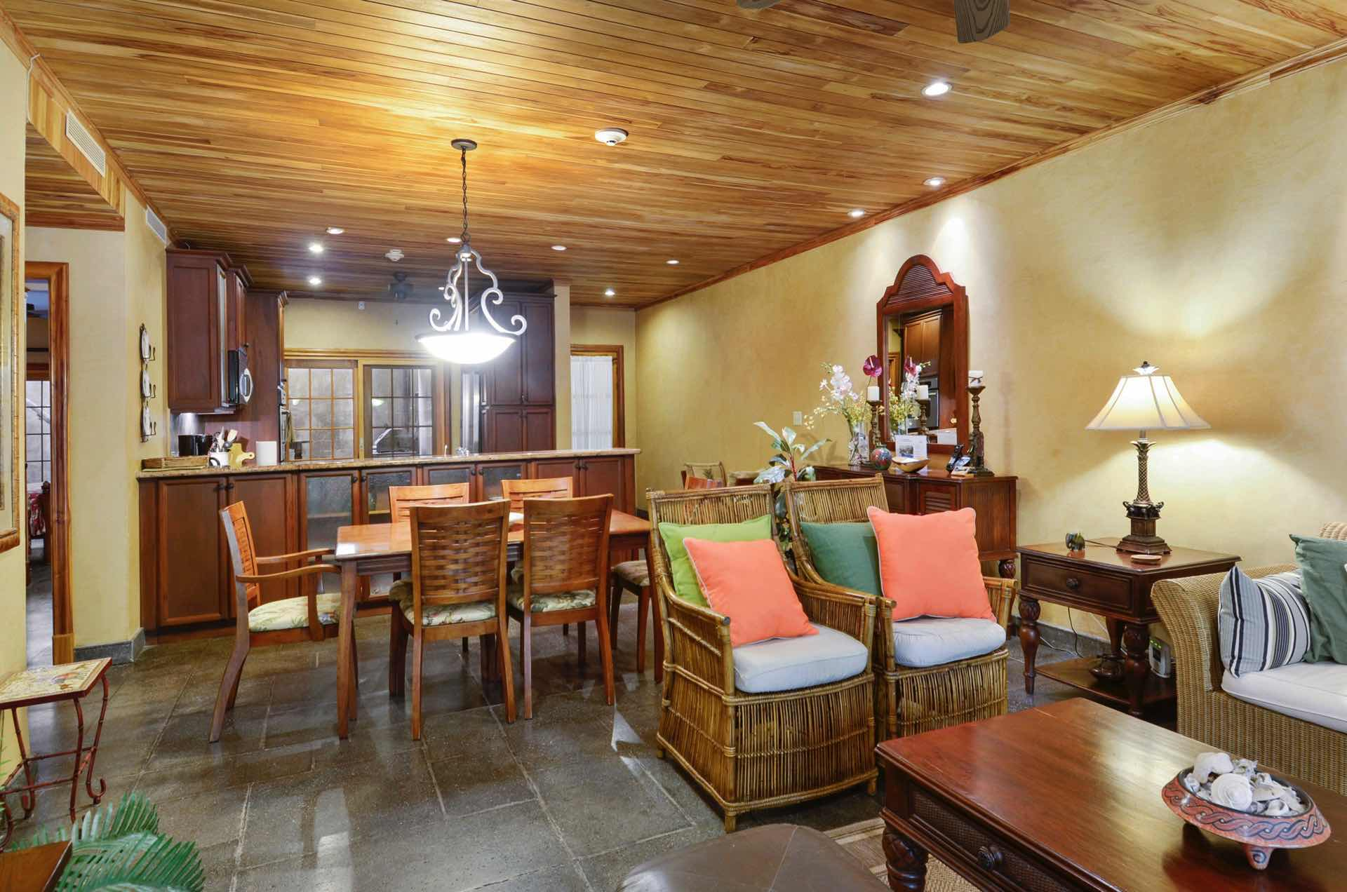 Natural wood ceilings and stone tile floors at La Esquina