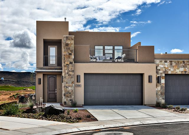Snow Canyon Sunrise is a 2692 square foot luxury villa with 4 bedrooms and 3.5 bathrooms and is located by the green on hole nine at The Ledges Golf Club.