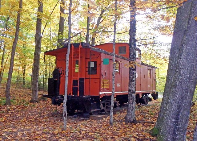 The Caboose, nestled onto a beautiful, wooded piece of property at the base of the Sleeping Bear Dunes!