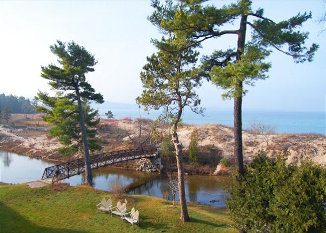 View of the Crystal River, the footbridge crossing to the beach, and Lake Michigan from the deck of the condo.