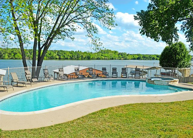 Enjoy all this home has to offer - the pool, hot tub, dock, kayaks - all on beautiful Lake LBJ!