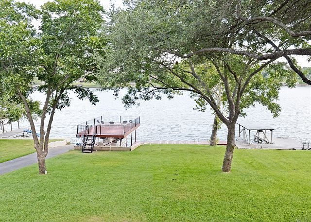 Relax on the Party Deck over the lake while the kids enjoy the large yard with plenty of room to run and play.
