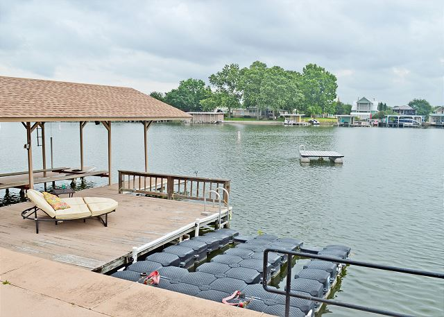 Bring the water toys!  Covered Boat Slip with Pontoon Lift and Dual Jet Ski platform are available for your use