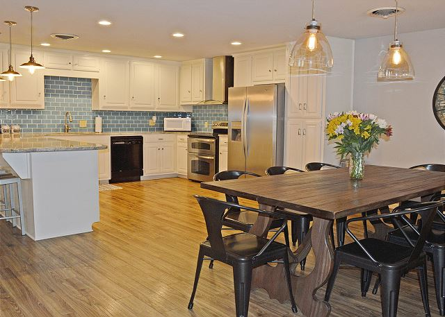 A large kitchen, a bar that seats 4 and a dining table that seats 8 offers a great place for the family to gather.