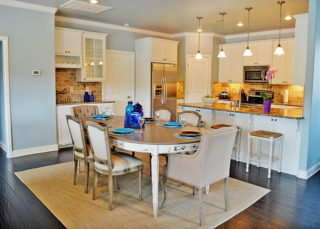Beautiful eating area on the main level.  Kitchen is fully stocked with dinnerware, pots, pans, silver and glassware